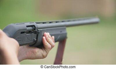 Modern shotgun firing and a cartridge case falling out...