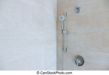 Modern shower head in bathroom with new home construction