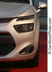 modern silvery car at an exhibition close up
