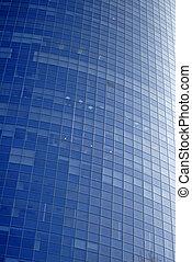 Modern sky-scraper close-up toned in blue color