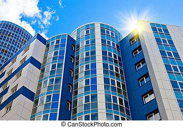 Modern skyscraper on blue sky background