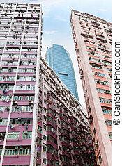 Modern Skyscraper Rises Above Old Buildings in Hong Kong