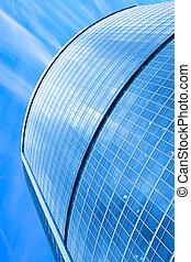 Modern skyscraper under blue sky - Modern skyscraper close-...