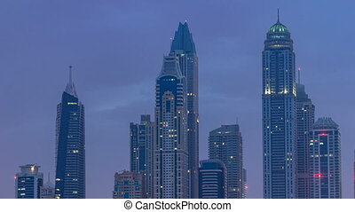 Modern skyscrapers in Dubai city night to day timelapse from...