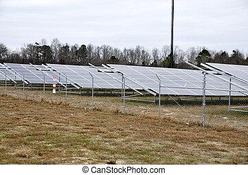 Modern Solar Farm - Series of solar panels in a huge field
