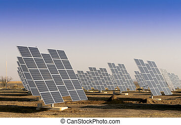 Modern solar power plant in the sunny plain. - Solar panels...