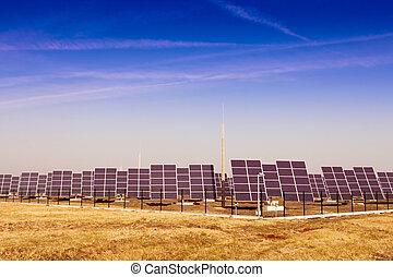 Modern solar power plant in the sunny plain.