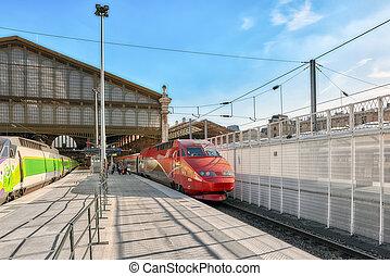Modern speed passenger train on railways station Gare De...