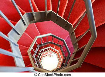 modern spiral staircase with red carpet