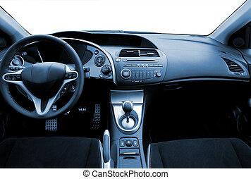 Modern sport car interior toned in blue