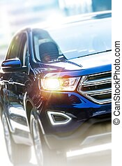 Modern Sport Utility Vehicle. Dark Blue SUV Car Closeup...