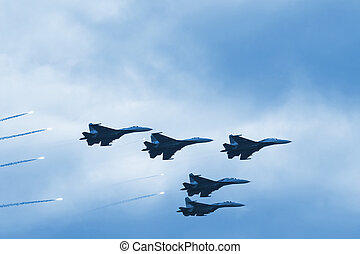 Modern squadron of military planes shooting rockets