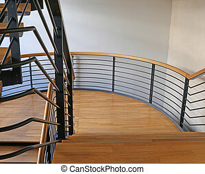 modern stairs steel and wood in a modern building with parquet