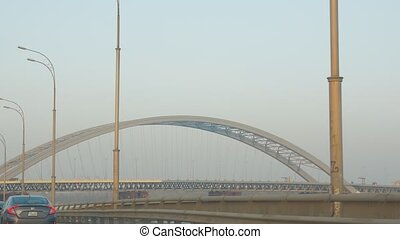 Modern steel bridge view from driving car