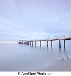 Modern steel pier in a cold atmosphere Long exposure ...