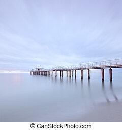 Modern steel pier in a cold atmosphere Long exposure ...