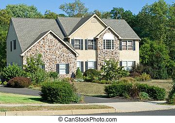 Modern stone faced single family house in suburban...