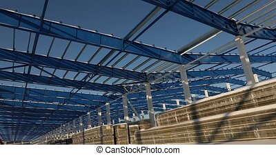 Modern storehouse construction site, the structural steel...