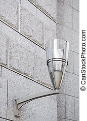 Modern street lamp on the wall.