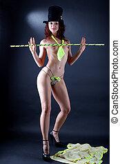 modern strip dancer against black background