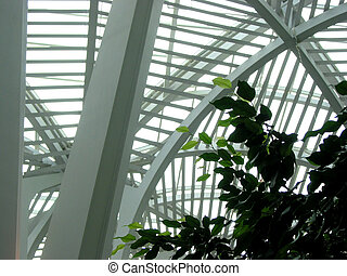 Fragment of a modern building structure with indoor tree