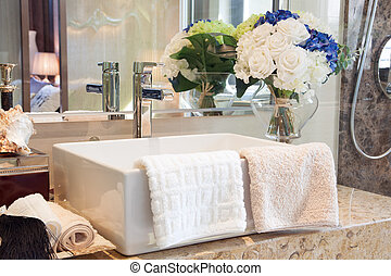 Modern style bathroom design with hand wash basin and other...