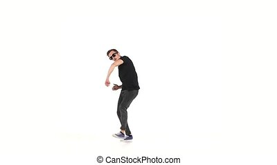 Modern style dancer continue dancing brake-dance, on white, slow motion
