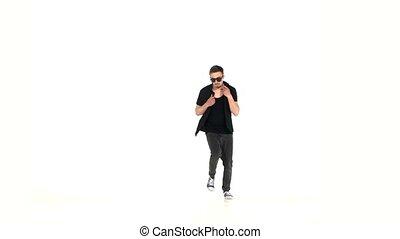 Modern style dancer dancing brake-dance, on white