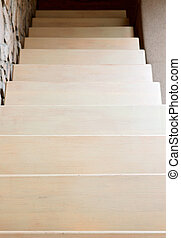 Modern style staircase in beige tones, interior detail, top view