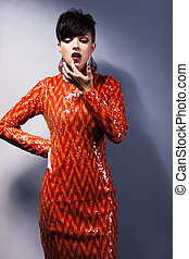 Modern stylish arrogant woman in red dress. Fashion style
