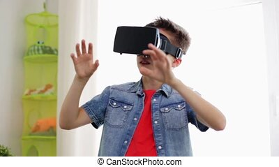 boy in virtual reality headset or 3d glasses - modern...
