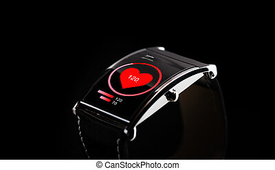 close up of black smart watch with heart rate icon - modern...