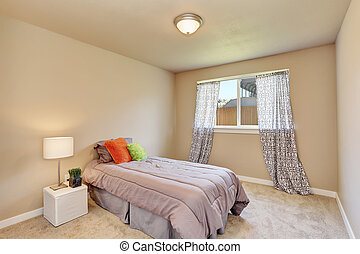 Modern teen bedroom interior with grey bedding.