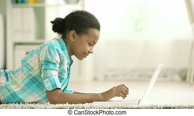 Modern teenager - Lovely teenage girl working on her laptop ...