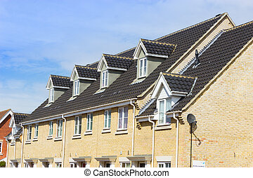 Modern terrace houses. Small terraced houses in a suburban area in ...