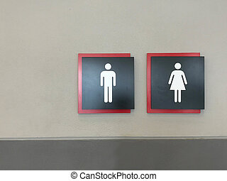 Modern toilet sign on gray cement wall