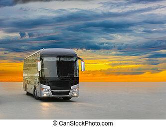 bus on asphalt in the evening on sunset