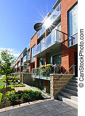 Modern townhouses - Modern town houses of brick and glass on...