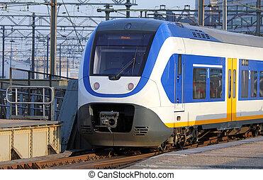 modern train leaving station