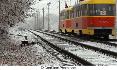 Modern tram in the city at winter day