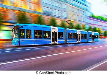 Modern tram on city street in Stockholm, Sweden