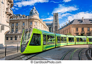 Modern tram on the streets of the old town of Reims, France