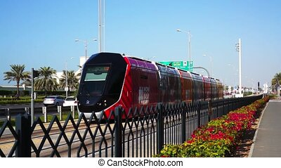 Modern tram. Public transport in Dubai. UAE. - Modern tram....