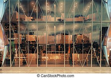Modern transparent business center at night