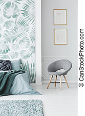 Modern upholstered chair in bedroom
