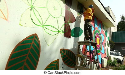 Modern urban art - Young man writing graffiti