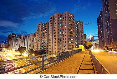 modern urban city at night with freeway traffic
