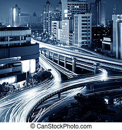 Modern urban viaduct at night - Freeway in night with cars...