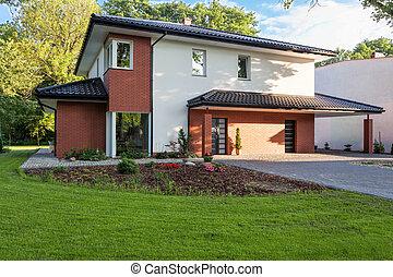 Modern villa - A modern villa with a trim garden