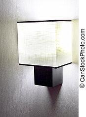 Modern wall lamp on wall.